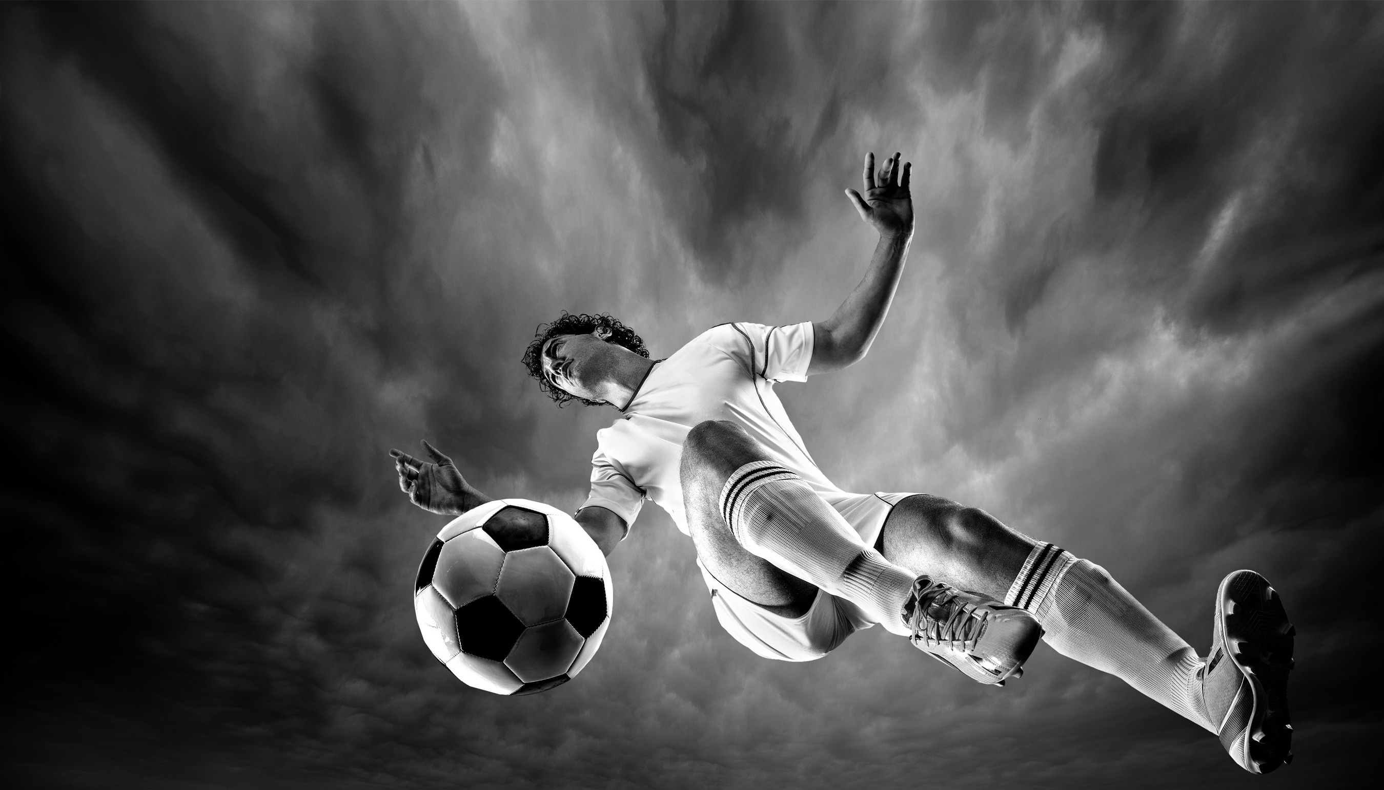 Soccer player kicking ball | Dovis Bird Agency Photography