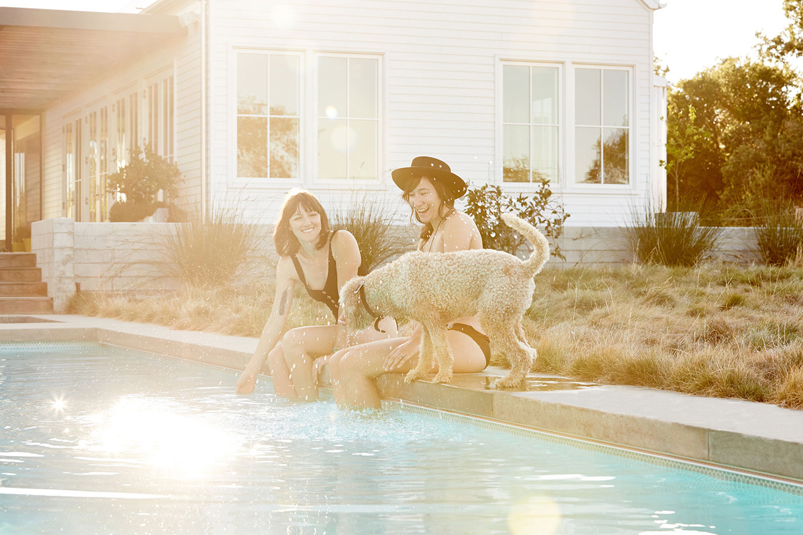 Friends poolside with dog laughing  | Dovis Bird Agency Photography