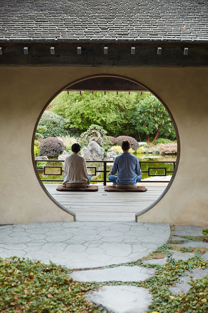 Couple meditating at spa in Japanese garden | Dovis Bird Agency Photography