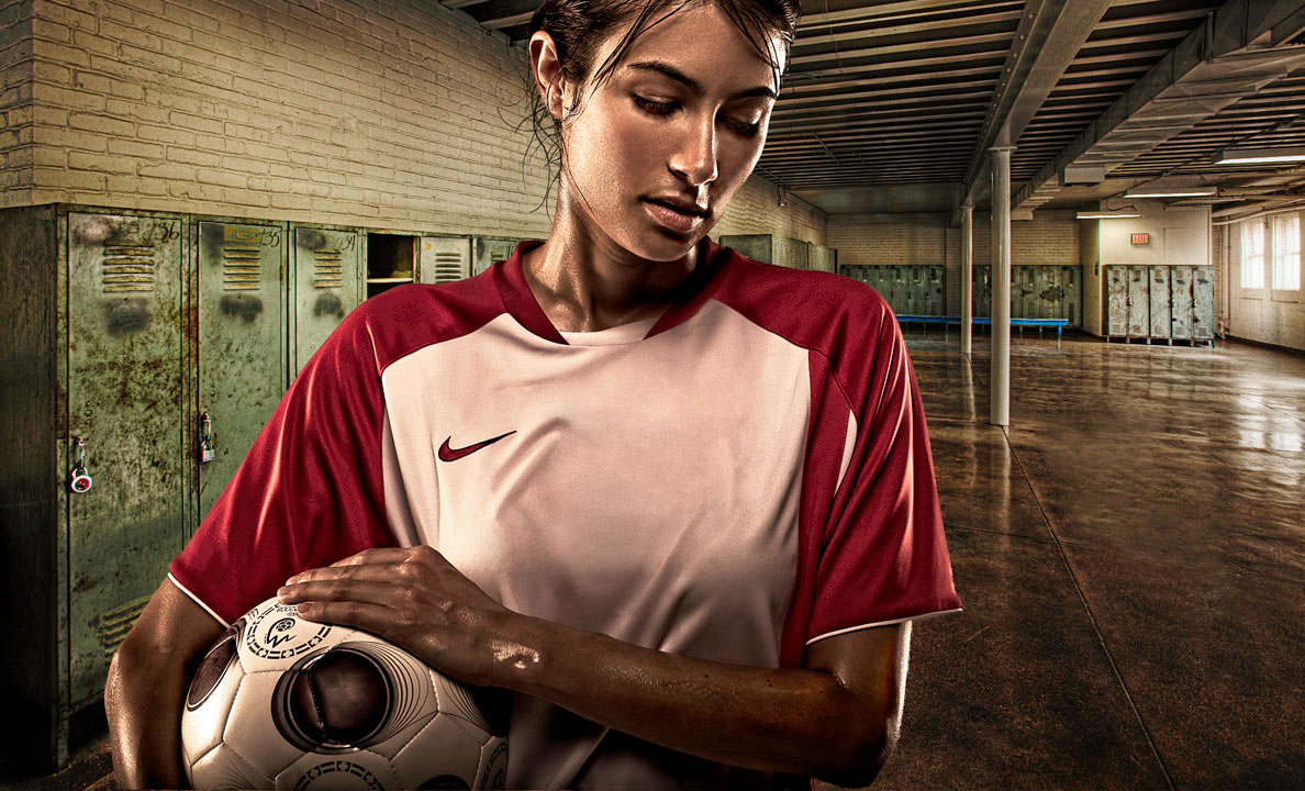 Female soccer player with ball | Dovis Bird Agency Photography
