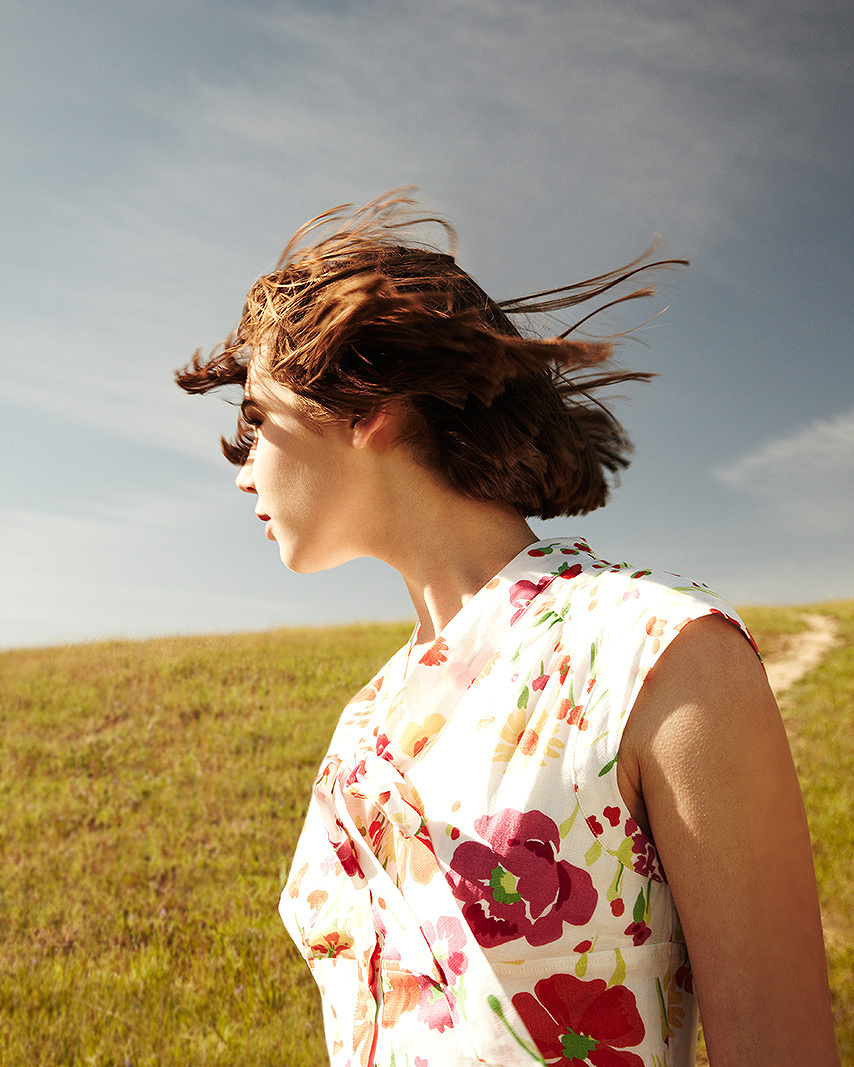 Teenage girl looking away with her hair being blown by wind