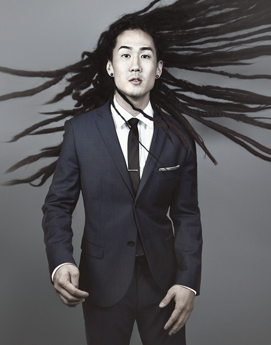 Man dressed in suit with dreadlocks | Dovis Bird Agency Reps