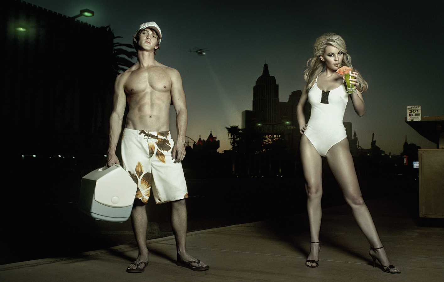 Man and woman wearing bathing suits |Dovis Bird Agency Reps