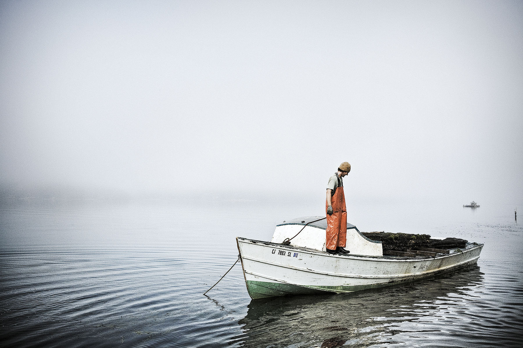 Old World Fisherman in Boat | Dovis Bird Agency Photography
