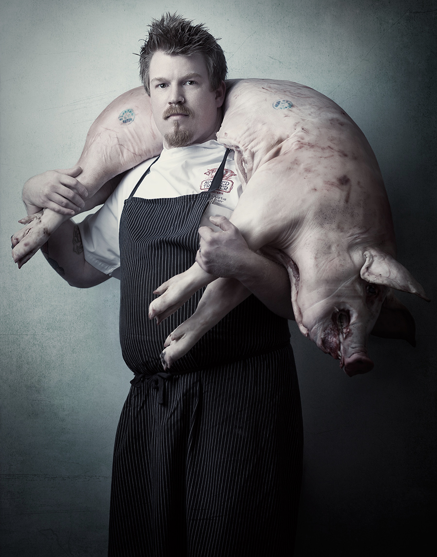 Portrait of Chef Kevin Ouzts with pig   | Dovis Bird Agency