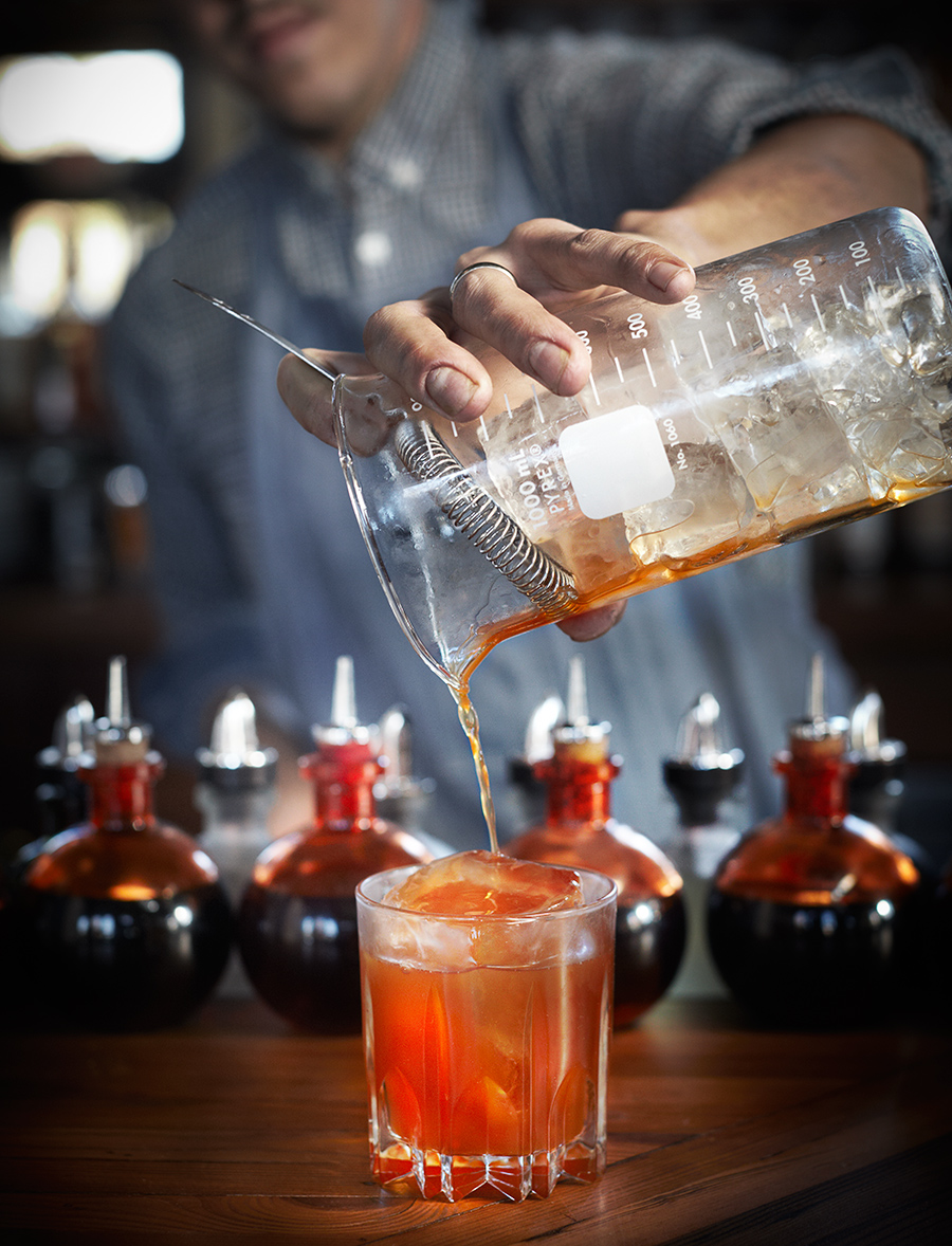 Bartender mixing drinks at bar  | Dovis Bird Agency