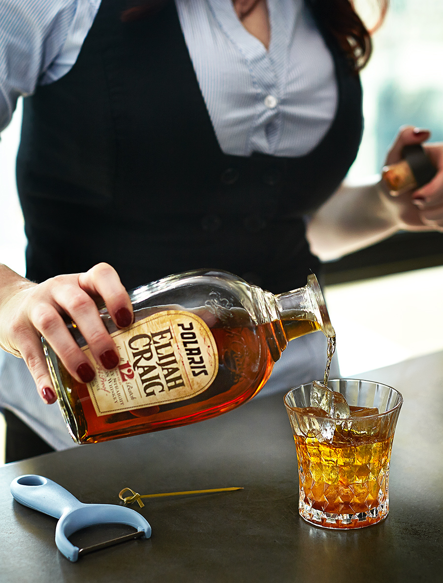 Bartender mixing Elijah Craig Whiskey drinks | Dovis Bird Agency