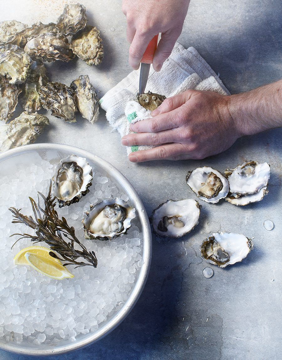 Shucking oysters Kimball House Restaurant | Dovis Bird Agency