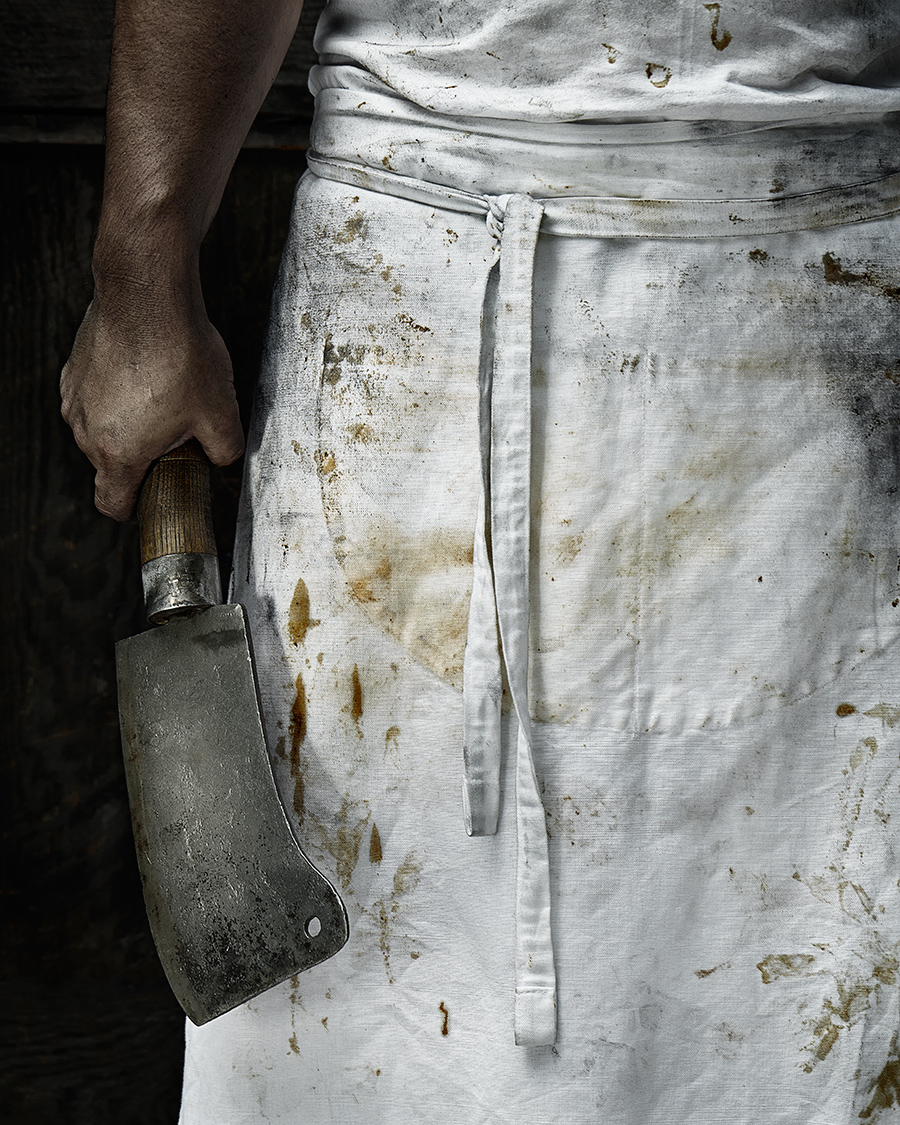 Butcher with cleaver wearing apron  | Dovis Bird Agency