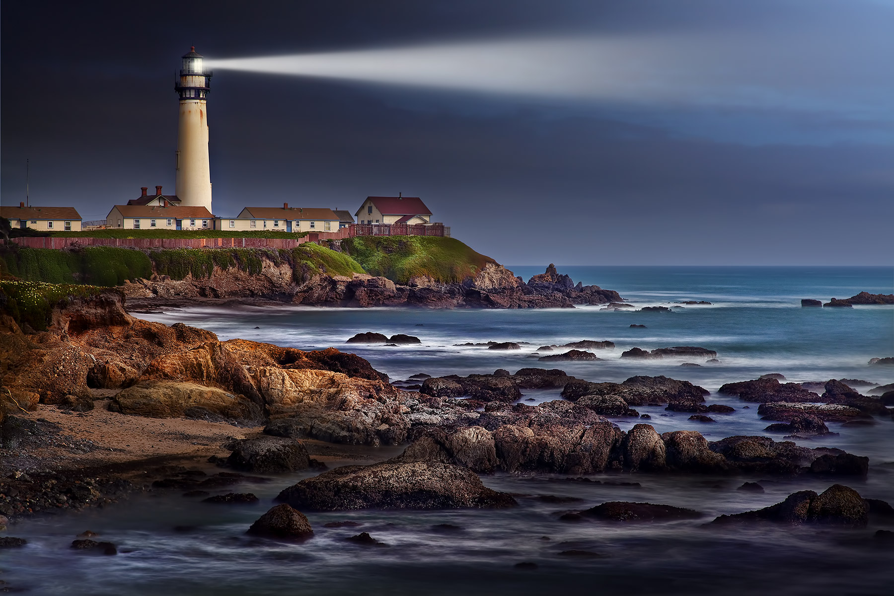 Lighthouse with beam California Coast| Dovis Bird Agency Reps