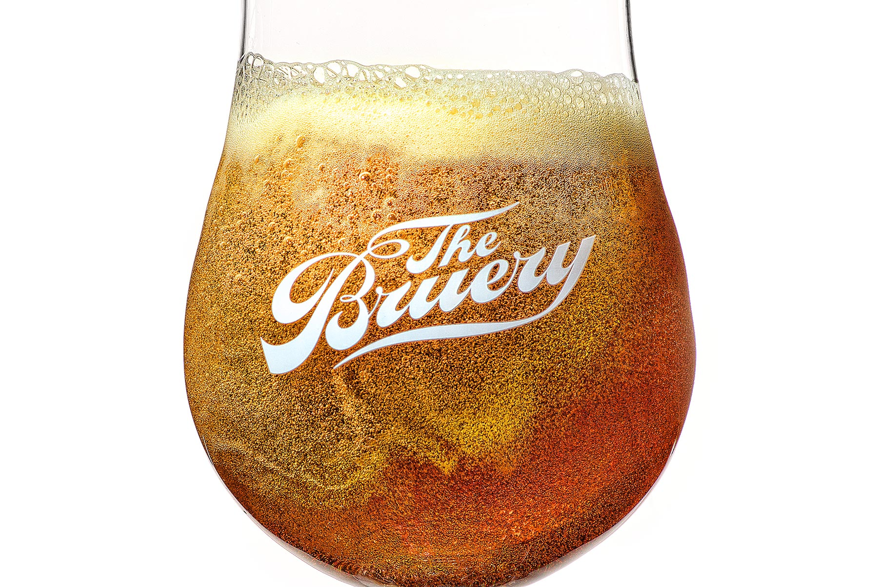 Closeup of beer in glass with bubbles | Dovis Bird Agency Reps
