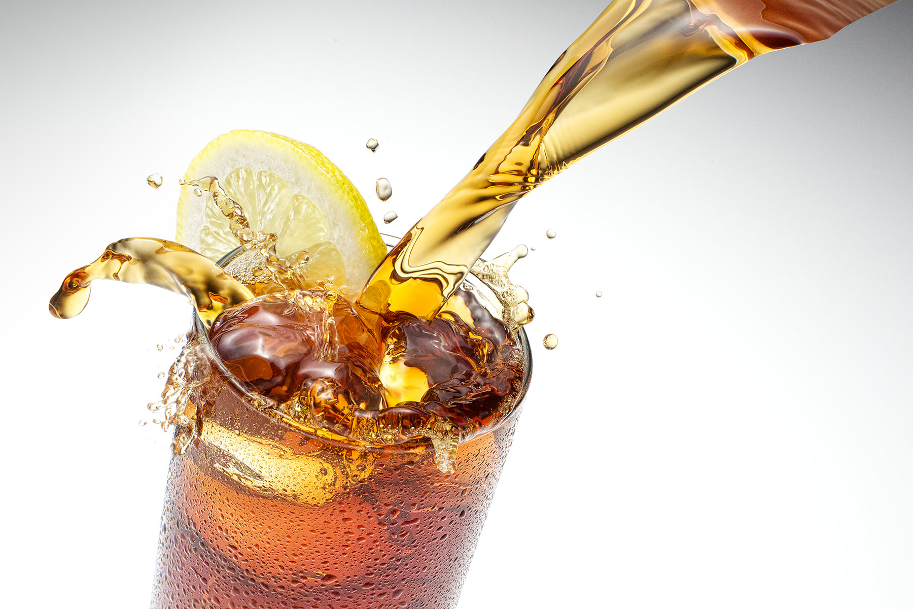 Iced tea pouring into glass | Dovis Bird Agency Reps