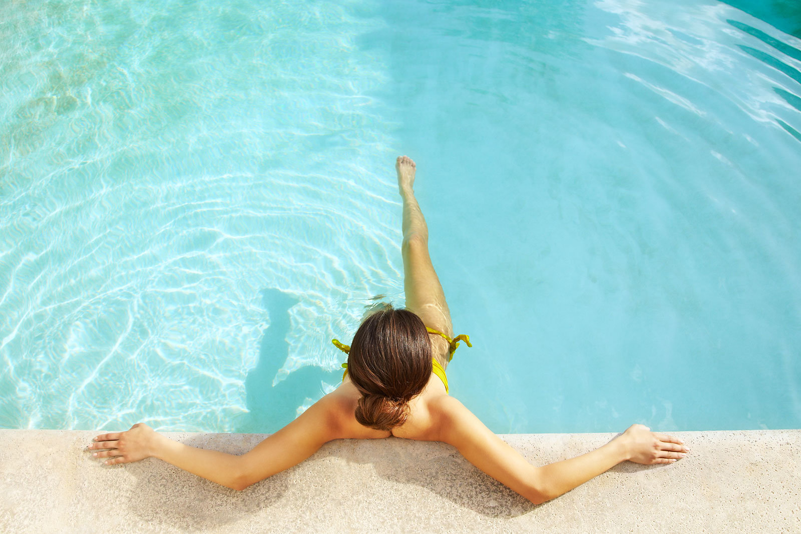 Woman relaxing is swimming pool