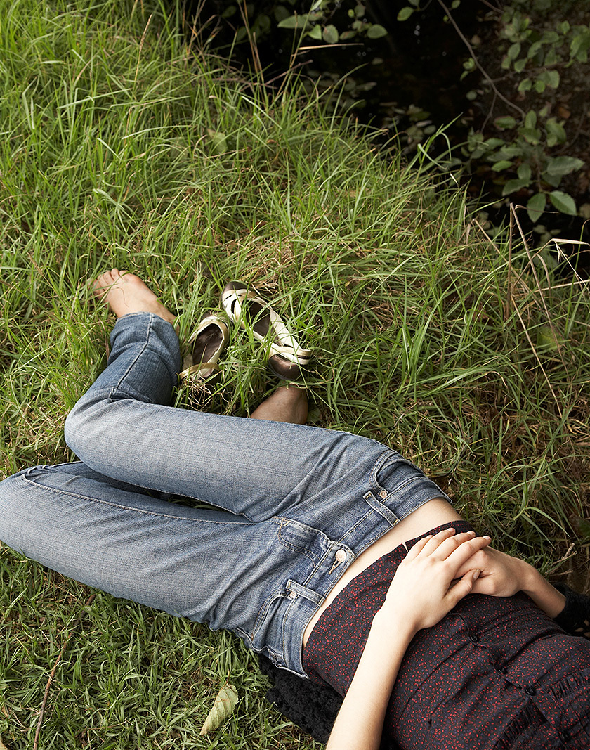woman laying in grassy field  | Dovis Bird Agency Photography