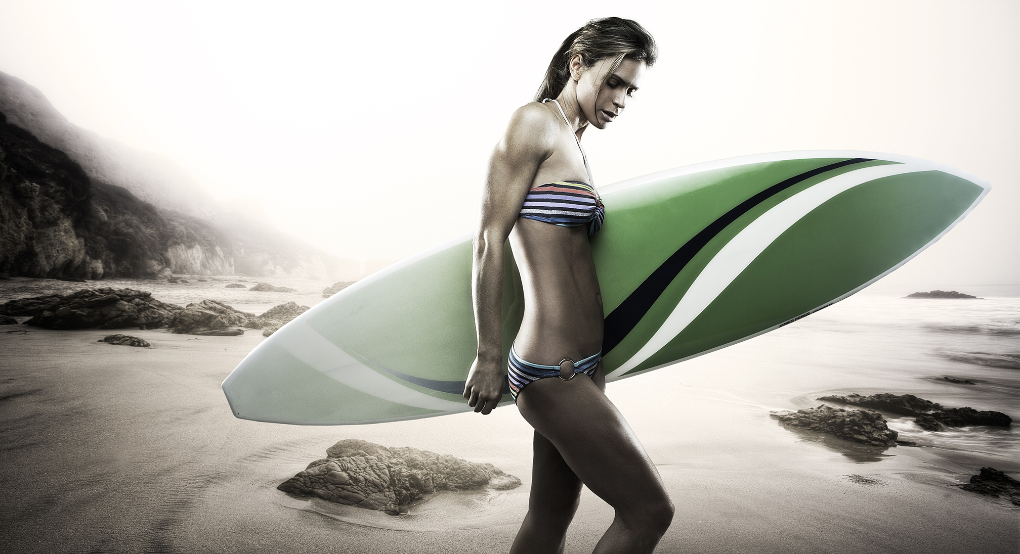 Woman on beach with surfboard | Dovis Bird Agency Photography