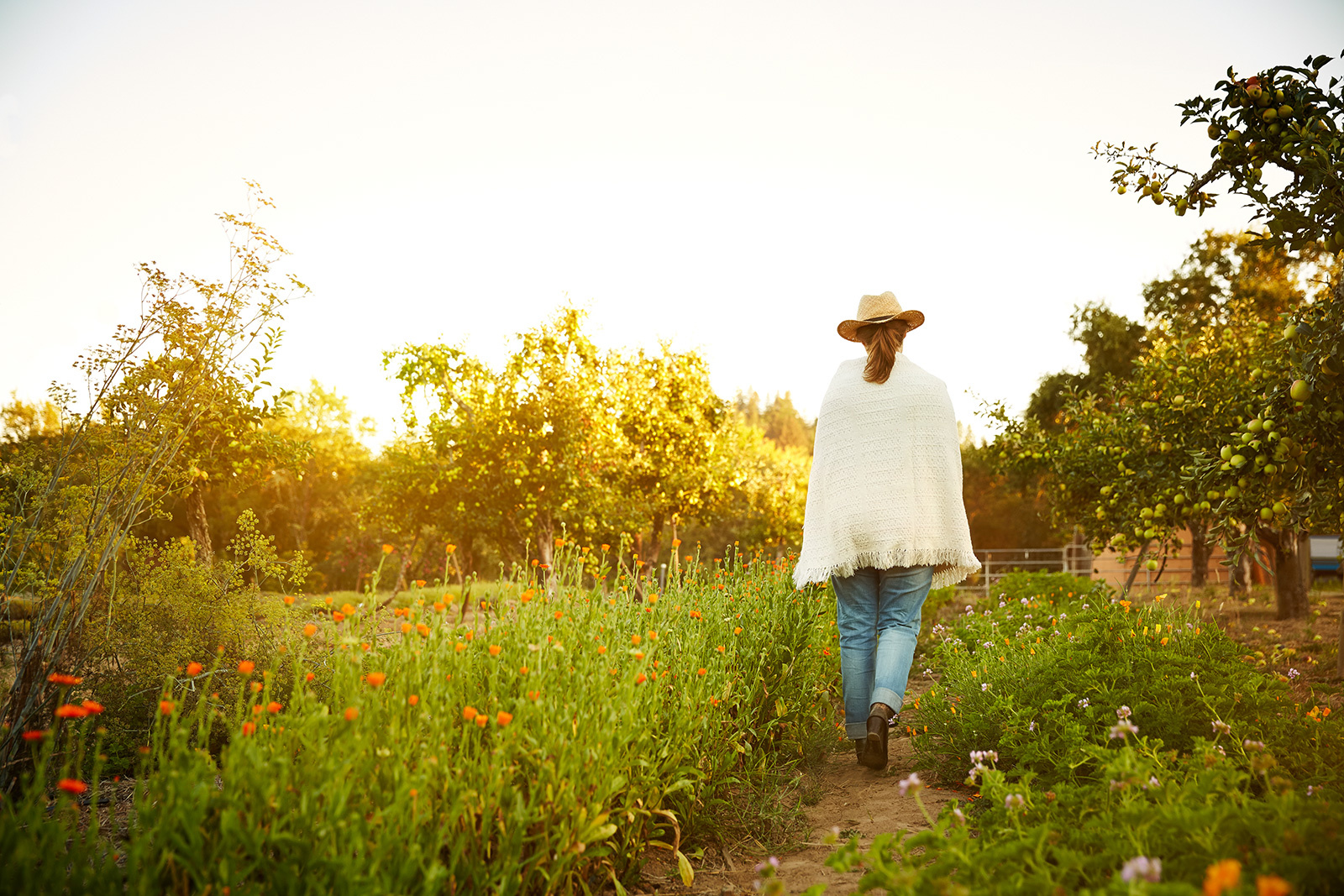 Woman walking in flower garden  | Dovis Bird Agency Photography