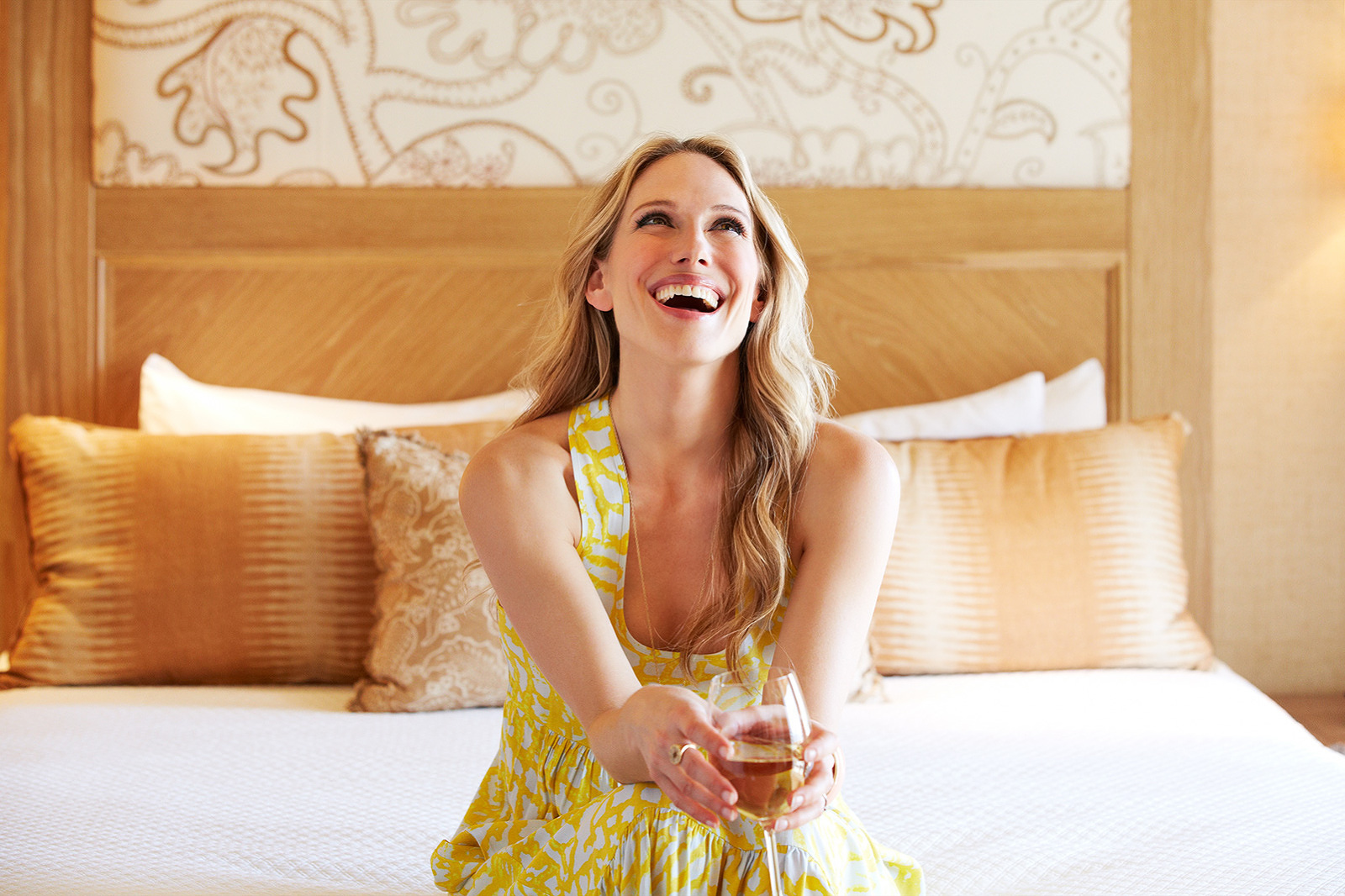 Woman laughing in bed  | Dovis Bird Agency Photography