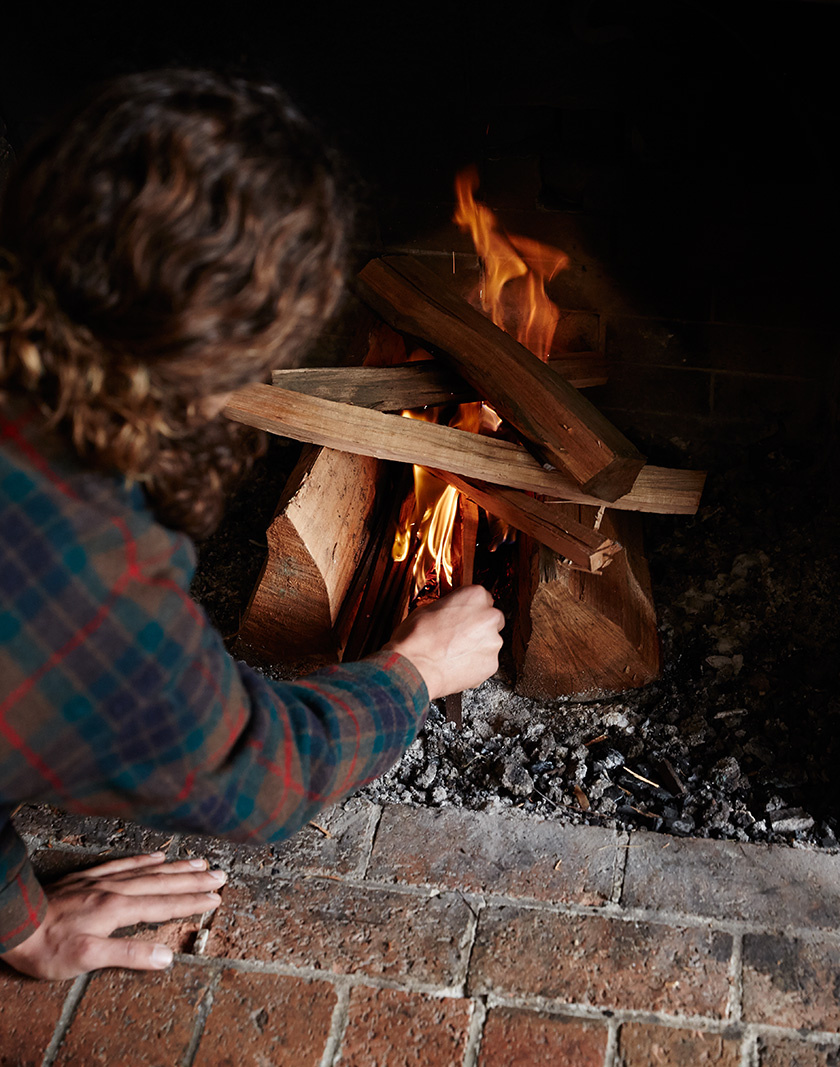 Lighting fire in cabin fireplace  | Dovis Bird Agency Photography