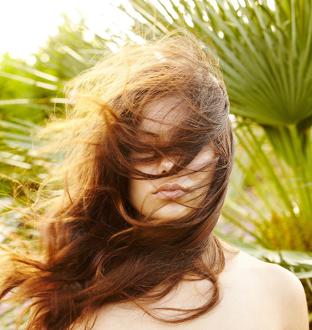 Portrait of young woman hair blowing in wind  | Dovis Bird Agency Photography