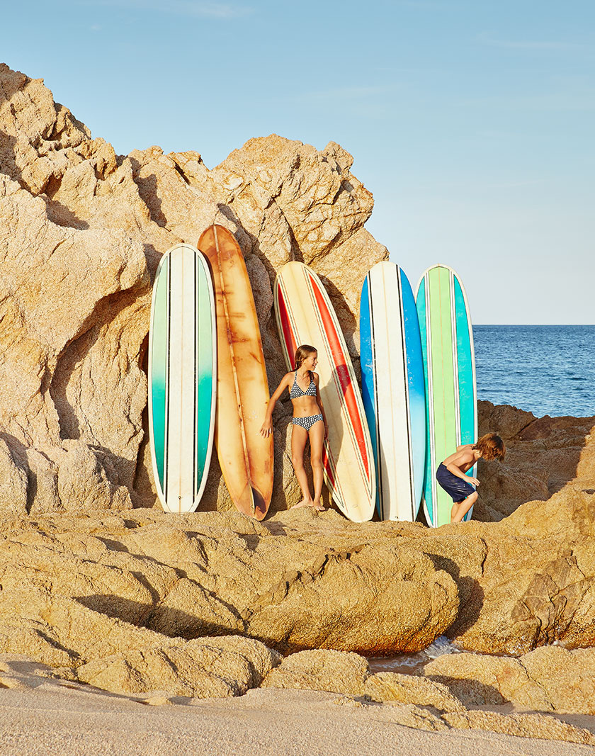 Kids on vacation surfing in ocean  | Dovis Bird Agency Photography