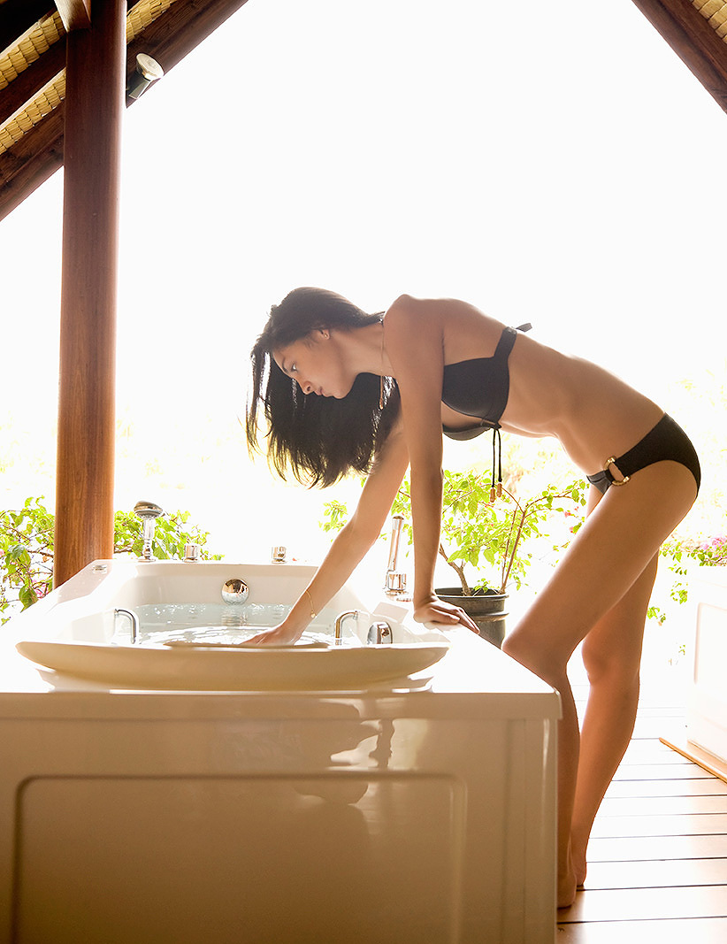 Woman getting into Jacuzzi  | Dovis Bird Agency Photography