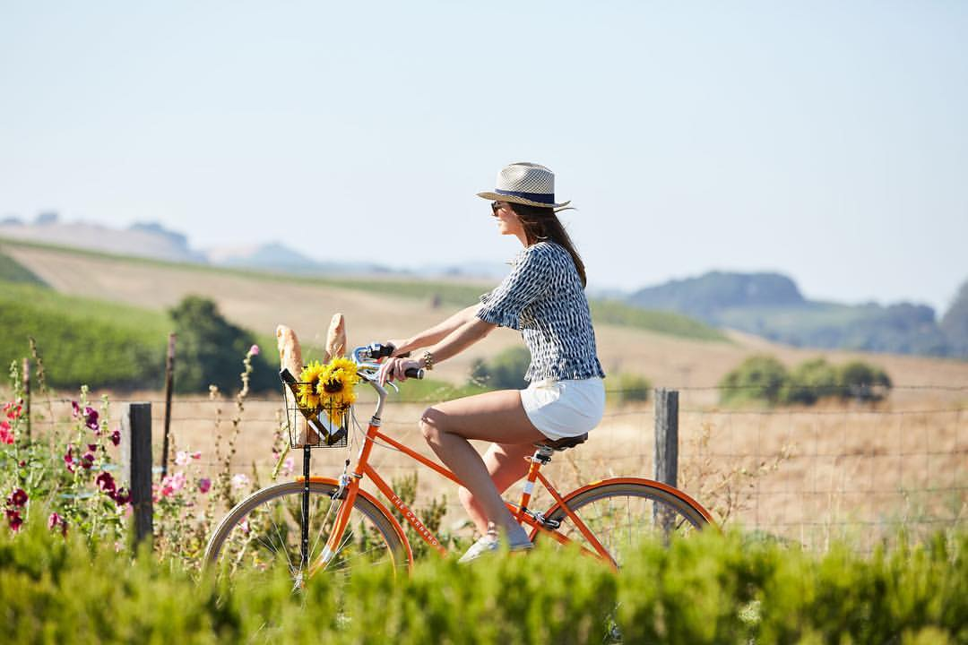 Woman riding bike in Napa wine country